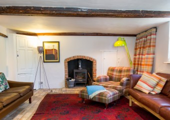 Home from home - warm welcome in the sitting room at Keep Cottage - we have a mid century vibe going on