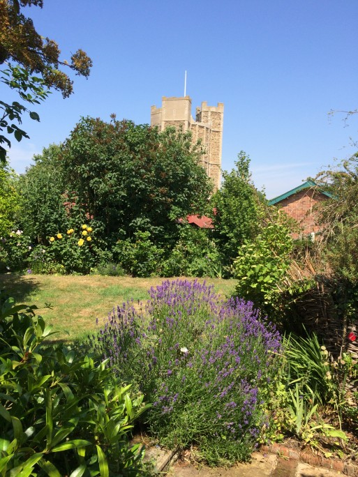Side garden and view of Orford Castle Suffolk
